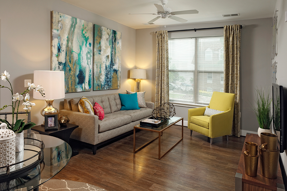 3350 at Alterra living room with couch, large window and wood like flooring