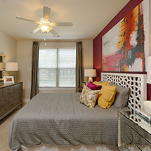 3350 at Alterra bedroom with large windows, carpet, bed and dresser